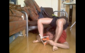 Benji in cheststand reading a book